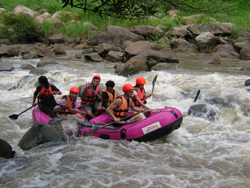 Take a white water rafting along the river for 1 hour