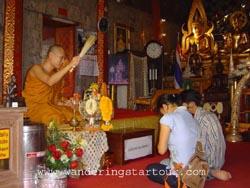 Morning Arm Giving- Doi Suthep Temple
