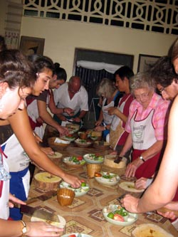 learn how to cook real Thai food in a traditional Thai setting.