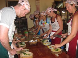 learn how to cook real Thai food in a traditional Thai setting