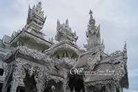 Visit  White Temple. Wat Rong Khun is unique from other temples as it is white in color. Combine the white with glass mosaics and this Temple sparkles!