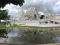 See the incredible 'White Temple' in Chiang Rai (Wat Rong Koon),