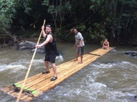 enjoy bamboo rafting along the river